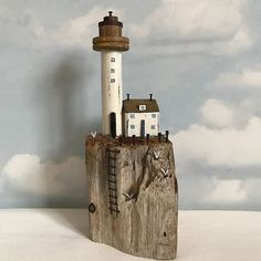 Lighthouse Rock, Lighthouse is a vintage bobbin. #shabbydaisies #shabbychic #driftwood #driftwoodart #rustic #rusticart #nautical #lighthouse #woodenhouse #seaside #handmade