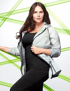 A lightweight layer that's made to move, our silver anorak jacket tops off any workout ensemble for a little extra warmth. Sheer silver jacket is simply detailed with energetic racing stripes, and features zipped pockets for convenience on the go. Flattering fit includes a vented back, hood and drawstring waist to adjust the silhouette. Zip-front closure. lanebryant.com