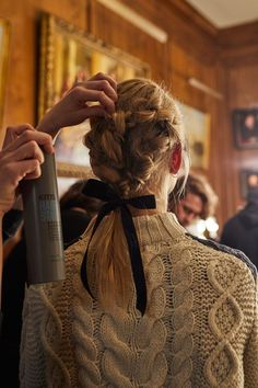 We're almost at the end of fashion month, and it's fair to say that this season hair was kept simple on the catwalks - we've seen a lot of side partings, tousled waves and low ponys. But at the Simone Rocha show oversized braids took centre stage, tied with a black velvet ribbon, the romantic 'do is perfect for the colder months.