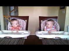 Baby twins dance to their dad's guitar. I love how they light up and look at each other when he starts :) You can't watch this and not smile. So precious!!