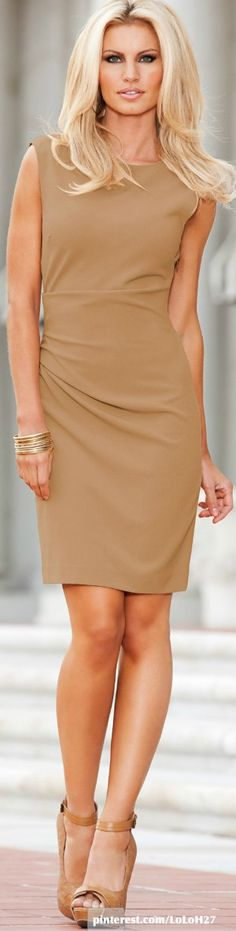 This dress can easily be combined with a black blazer to make it business appropriate - claaseconsultancy