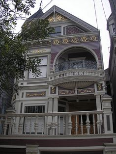 A San Francisco Victorian with incredible details!  The round arch over 2nd or 3rd floor balcony is cute, but all the embellishments are wonderful. Using gilded gold as part of the palate seems a little opulent, but opulence is the hallmark of Victoriana, and the owners have done an excellent job of showing off the architectural details of this house.