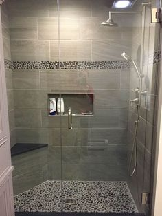 Large charcoal black pebble tile border shower accent. https://www.pebbletileshop.com/gallery/Charcoal-Black-Pebble-Tile-Border-Shower-Accent.html#.VVOCPCFViko