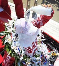 Race winner Dario Franchitti pours the ceremonial bottle of milk over his head after the race. The 96th Indianapolis 500 race was held at the Indianapolis Motor Speedway Sunday, May 27, 2011. (Mike Fender / The Star)