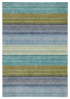 Brushstroke Rug, Blue - This company promotes ethical sourcing of all of its materials. This beautiful Brushstroke blue rug shows off a vari...Company C