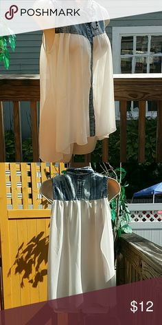 🐞 SUNDAY SUMERTIME CLOSET CLEANOUT! GET IT WHILE ITS HOT! 🔥a beautiful Denim and sheer sleeveless Rue 21 size medium blouse! This is super cool, casual can be worn with shorts, jeans, a skirt beautiful all the way around very flowy and flattering! Please make an offer cleaning out the  summer items  and getting ready for fall my favorite months! HAPPY POSHING! Rue 21 Tops Blouses