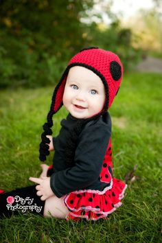 Cute little girl in red & black ladybug costume.