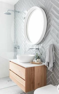 Grey herringbone subway tile on modern bathroom with floating vanity, white vessel sink and round mirror bathroom Minimalist Bathroom Design, Simple Bathroom Designs, Modern Bathroom Design, Bathroom Interior Design, Modern Minimalist, Interior Ideas, Contemporary Bathrooms, Minimalist Interior, Minimalist Living