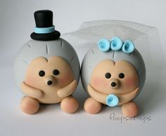 These cute hedgehog bride & groom are made to order. Their bodies are gray, the faces and paws are light beige. The bride wears a tulle veil. They are 1.8 inches tall (4.5 cm) and about just as wide. You can choose the colors of the details. When you order please let me know: - the color of the top hat and hat band - the color of the flowers If you have any questions about these hedgehogs please feel free to ask. Thanks for looking! ©Fliepsiebieps. All rights reserved.