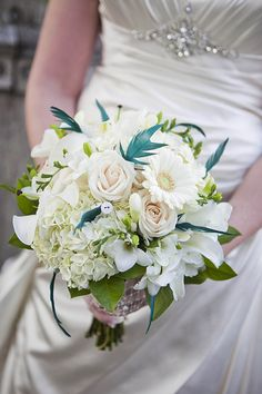 Turquoise feathers in your bouquet. New Jersey Wedding {Ashley Bartoletti Photography}