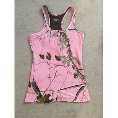 Pink CAMO Realtree tanktop It's a very nice material tank top. It isn't thin material! I never wore it! Size small, true to size Tops Tank Tops