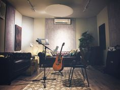 Zulfiqar Jabbar Khan, popularly known as Xulfi to music listeners in Pakistan, created a recording studio in a perfect mix between a cosy living room and the passion for music. Professional Audio, Recording Studio, Cosy, Pakistan, Passion, Living Room, Music, Table, Painting