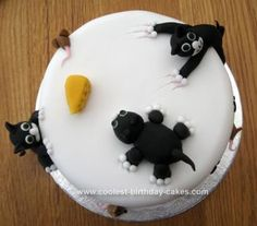 Homemade Naughty Cat Cake: I made this naughty cat cake for the mum of a lady at work. Her mum had a cat that had the same personality and looks as Felix from the cat food adverts,