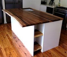 Slab Top Kitchen Island with White Cabinets & Slab Shelves