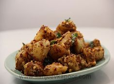 Spicy Peanut Potatoes Recipe - Boiled and cubed potatoes cooked with roasted spices.