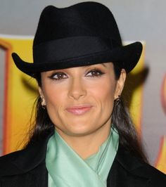 Salma Hayek rocks a derby hat. Compare styles on Amazon at http://buyfascinatorhats.com