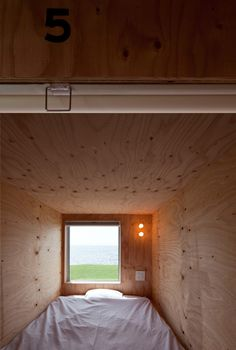 Views of Tokyo Bay from this capsule accommodation by Japanese office Yasutaka Yoshimura Architects.