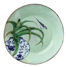 An original ceramic work by Lisa Ringwood entitled: 'Wagtail and Aloe (green round platter)', ceramic, d 35cm. For more please visit www.finearts.co.za #ceramic #LisaRingwood