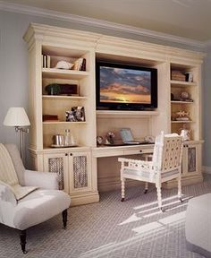 Desk built into the tv unit...this would be great for the guest room!