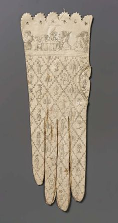 Woman's glove, Spanish, 1790-1810, White kid printed in black: diamond lattice with figures insects and flowers; border of men and women in various attitudes. Punched and pinked edge. Museum of Fine Arts, Boston, Accession#43.1991