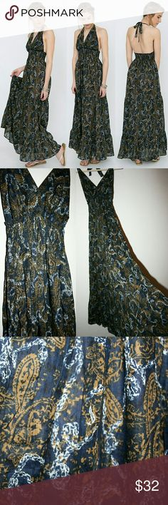 Nautical Paisley Print Halter Maxi Dress NWOT I love this lightweight, feminine maxi dress! The halter neckline has adjustable straps that tie behind your neck. A stretchy shirred panel under the bust keeps it fitted, and it floats away from the body below this panel in a beautiful, airy way. The distressed print is of golden paisley and white ropes on a navy background, which gives this dress nautical/beachy vibes. The fabric is 100% cotton. Stretchy/adjustable means it fits many sizes, and…