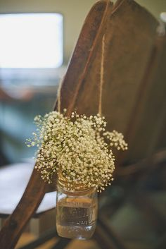 For the rustic bride -  baby's breath in hanging mason jars. For more wedding planning tips, check out our website - http://bridalmentor.com/.