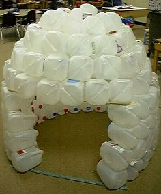 Milk Jug Igloo this would be fun to do with the kids when it starts getting clod outside. save all of your milk jugs all year... hmmm (;