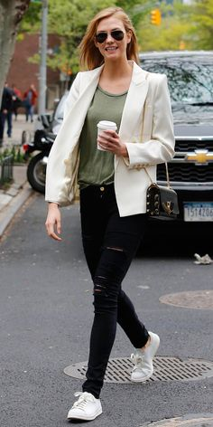 ADD POLISHED EXTRAS No errand is too small or inconsequential for a chic outfit. The secret to her polished, yet approachable streetwear? An arsenal of refined add-ons, like a crisp blazer and a chain-strap purse, that she can throw on with a casual tee, shredded skinnies, and white sneakers.