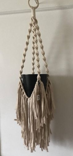 Single Hanging Macrame Planter handwoven with Cotton craft cord. Natural white color and edgy knot pattern and hanging tassels gives a modern bohemian feel, and compliments any color scheme and decor. -Can also be used as candle, or votive holder! -Perfect for herb growing, kitchen