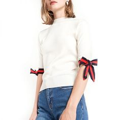 """- """"I'm channeling French girl vibes at the moment and love this bow-adorned top in place of simpler tees and knits.""""—Erin Nicole, Lifestyle EditorPixie Market Muse Stripe Bow Tie Knit Top, $68"""