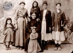 The Avedian family, Mezire, ca 1910. The young girl standing in the centre, holding a book is Parantsig/Victoria (1902-1973, father's name Hagop). Seated immediately in front of her is her mother, Varter Avedian. Standing on Parantsig's left is her elder sister Garine, who is a graduate of the Harput Central School (Source: Lance Kasparian collection)