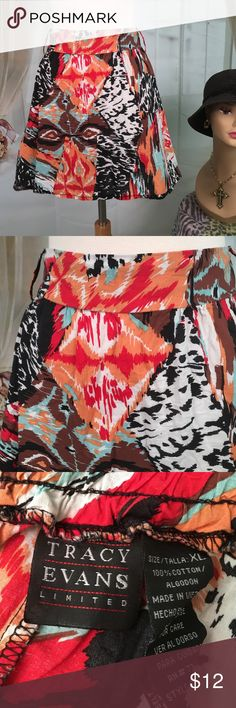 "Tracy Evans Multi Colored Cotton Skirt Today, featuring in Kaki Jo's closet is this cute light 100% cotton multi colored skirt.  Elastic waist in the back.  Has loops for belt.  Great condition.  Size XL.  Waist 38 and length is 16"". Tracy Evans Skirts"