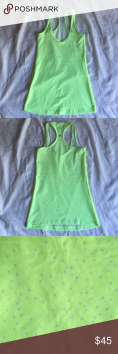 lululemon Cool Petit Dot Racerback Tank Maybe worn once. No snags, holes or stains. EUC. Size tag missing. Light smell of detergent. Neon green with lavender polka dots lululemon athletica Tops Tank Tops