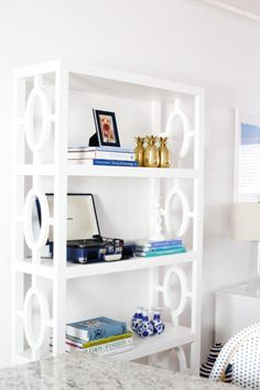 Beautiful Bookshelf Styling. Love the mod white bookcase.
