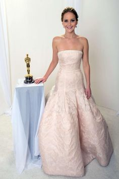 Take your picture with Jennifer Lawrence's Oscar for charity