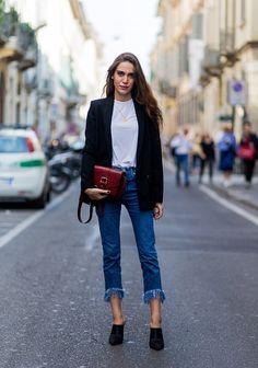 Anastasia Liuska wearing black Mango mules jeans with fringes black blazer and red bag during Milan Fashion Week Spring/Summer 2017 on September 25...