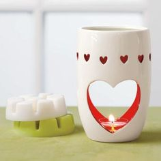 Warm Hearts Fragrance Warmer - Perfect for Valentines day or all year round! #white #red #heart #love #valentinesday #homedecor #warmer #melts #candles #partylite #scentsy http://www.partylite.biz/legacy/sites/nikkihendrix/productcatalog?page=productdetail&sku=P91362&categoryId=58466&showCrumbs=true