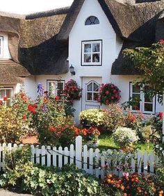 """On a cold dark January day a corner of England where the sun shines on a pretty little cottage with a lovely garden of flowers """"magical"""" love the little picket fence the thatched roof the lovely cottage flowers,I love English cottages. #cottagestyle #Cottagegarden #thatchedroofs #england #countrylanes #rosegardens #cottageplant #rosegarden #Anglophile #Magicalcottages #cottagechat #cottagei terrors #lovecottages #cottagestyle"""