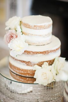 Pretty naked cake: http://www.stylemepretty.com/florida-weddings/osprey-florida/2016/07/16/modern-southern-outdoor-wedding/ | Photography: Justin DeMutiis