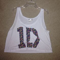 """One Direction Crop Top White tank top (cropped) with floral """"1D"""" on the front. ordered off Freshtops tagged for visibility, and it is a size small but fits kind of bigger yet cropped Forever 21 Tops Crop Tops"""