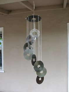 Directions on using parts from the inside of old hard drives to make wind chimes.