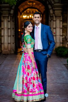 Bride in traditional indian sari of gold, pink and green with groom in blue suit Indian Engagement Photos, Indian Wedding Poses, Indian Wedding Couple Photography, Pre Wedding Poses, Indian Wedding Outfits, Indian Bridal, Indian Wedding Receptions, Photography Couples, India Wedding
