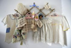 A Rack of Vintage Baby Clothes