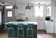 Kitchen Lab Linden, L-Shaped Kitchen with gray island, turquoise bar stools | Remodelista