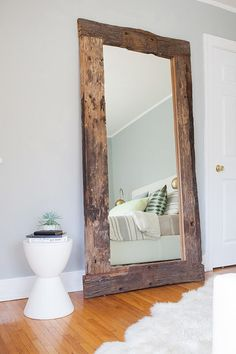 Use decorative floor mirrors to give the illusion of space: http://www.stylemepretty.com/living/2015/11/12/small-space-decor-solutions/