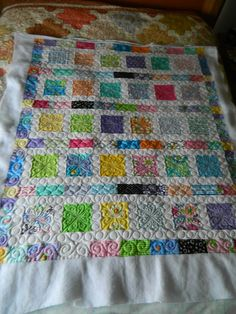 Cute baby quilt made with charm squares.