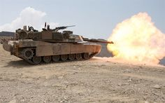 An M1A1 Abrams battle tank from Tank Platoon, Battalion Landing Team 1st Battalion, 9th Marine Regiment, 24th Marine Expeditionary Unit, fires off a 120mm round towards a target tank hull during a live-fire range in Djibouti, Africa, March 30, 2010.  The Marine tank platoon engaged various targets alongside the French Foreign Legion's 13th Demi-Brigade as part of a bi-lateral training exercise where both military forces learned about each other armored capabilities.  The 24th MEU performed…