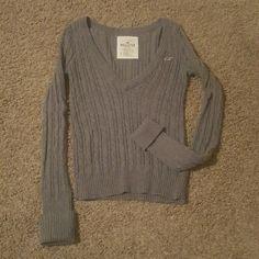 Hollister Sweater Deep V-neck sweater. Only worn twice, practically new. Has a maroon bird. Hollister Sweaters Crew & Scoop Necks