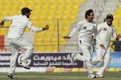 Pakistani players celebrate their win against England in Abu Dhabi Test.