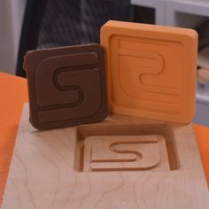 Crafters, what's next? What else can you make on your #STEPCRAFT #CNC #3dprinter? Why, Candy, of course. Why not! Making some #STEPCRAFT candy!. Carved maple + mold, food-grade silicone - mold, melted chocolate into the silicone mold and voilà...Candy! www.stepcraft.us #craftcandy #crafter #craft #candy Cnc Router, Ct Usa, Desktop Cnc, Melted Chocolate, Cnc Machine, Dremel, Diy Woodworking, Food Grade, Silicone Molds